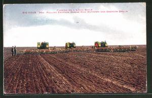 AK Traktoren beim Eggen eines Feldes