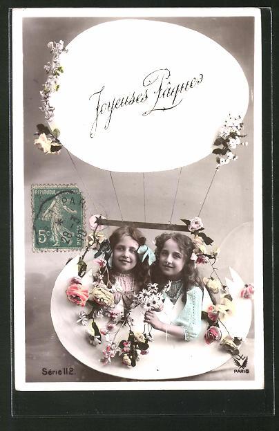 AK Joyeuses Pâques, Kinder in Osterei-Ballongondel, Kulisse