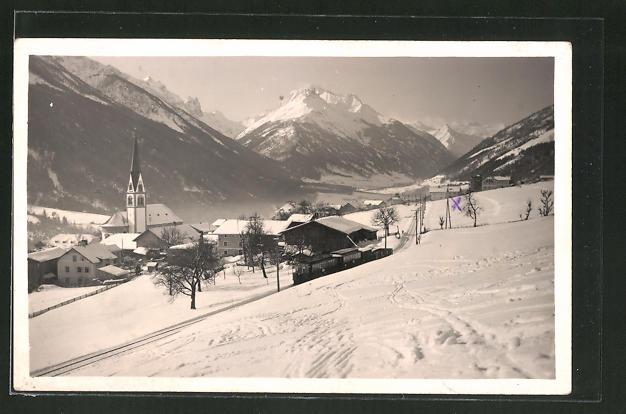 AK Telfes, Ortsansicht mit Kirche im Schnee
