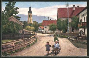 AK Lenggries a. d. Isar, Partie aus der Dorfstrasse mit Blick zur Kirche
