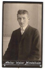 Fotografie Atelier Weber, Mindelheim, Portrait junger Mann mit zeitgenöss. Frisur