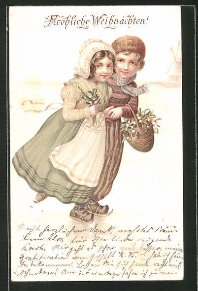AK Niederländisches Kinderpaar mit Schlittschuhen