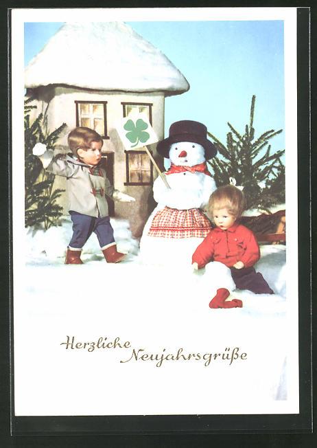 AK Käthe Kruse-Puppen bauen einen Schneemann