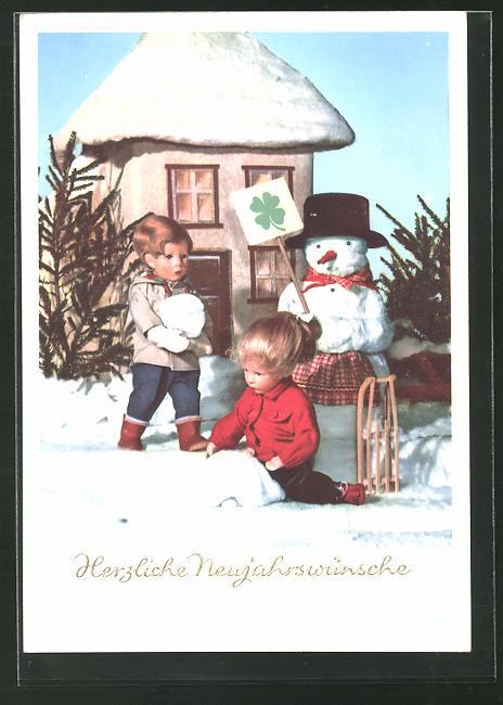 AK Käthe Kruse-Puppen mit Schlitten und Schneemann