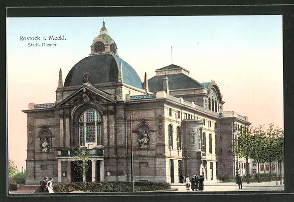 Goldfenster-AK Rostock i. Meckl., Stadt-Theater mit leuchtenden Fenstern