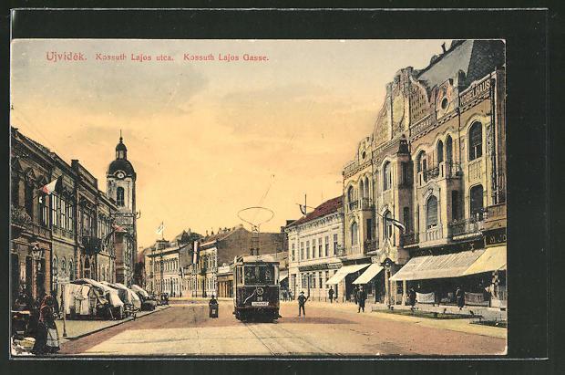 AK Ujvidek, Kossuth Lajos Gasse mit Strassenbahn und Geschäften