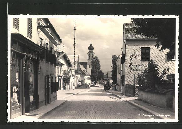 AK St. Georgen, Strassenpartie mit Gasthof und Kirche 0