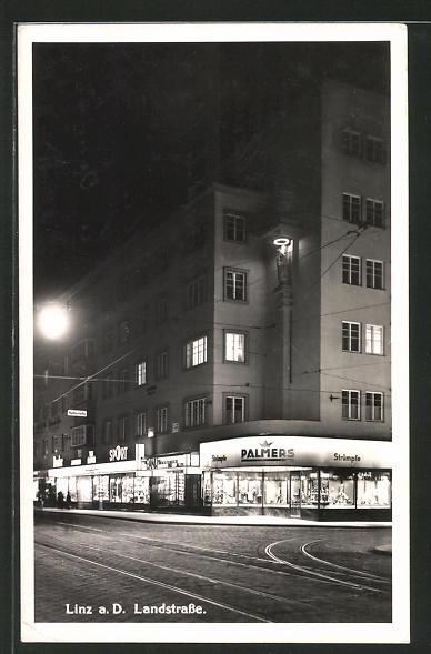 AK Linz a.D., Landstrasse mit Geschäften bei Nacht 0