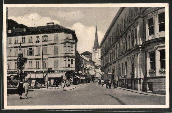 AK Bad Ischl, Strassenpartie mit Geschäften und Kirche 0