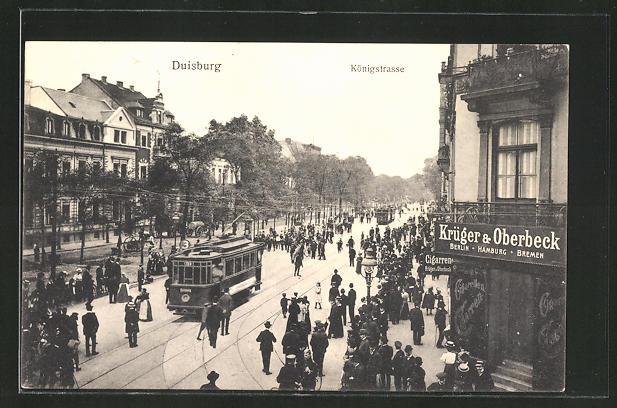 AK Duisburg, reges Treiben in der Königstrasse mit Strassenbahnen & Krüger & Oberbeck Geschäft 0