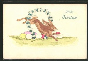 Präge-AK Osterhase springt durch einen Blumenkranz