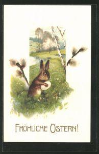 AK Osterhase klammert sich an ein Ei im Gras, Weidenkätzchen