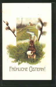 AK Osterhase klammert sich an ein Ei im Gras mit Weidenkätzchen & Bachpartie