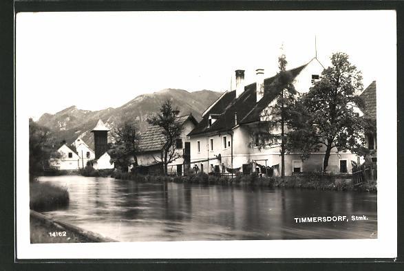 AK Timmersdorf, Ortspartie vom Wasser aus gesehen
