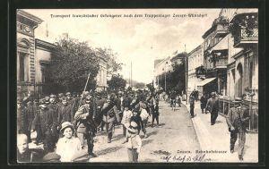 AK Zossen, Transport französischer Kriegsgefangener durch die Bahnhofstrasse ins Truppenlager Zossen-Zehrendorf