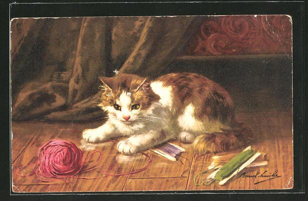 AK Katze spielt mit einem Wollknäuel