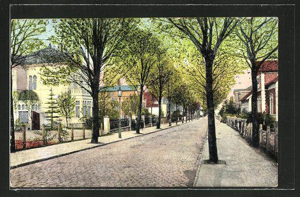 Goldfenster-AK Bramsche, Bahnhofstrasse und Häuser mit leuchtenden Fenstern