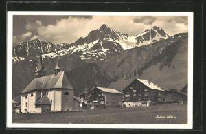 AK Sedrun, Ortspartie mit Kirche im Gebirge