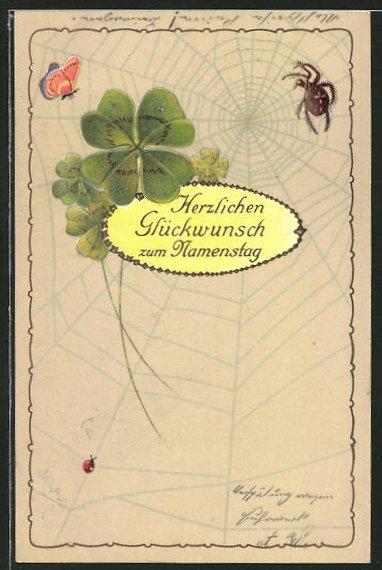 AK Kleeblätter und Schmetterlin vor dem Netz einer Spinne