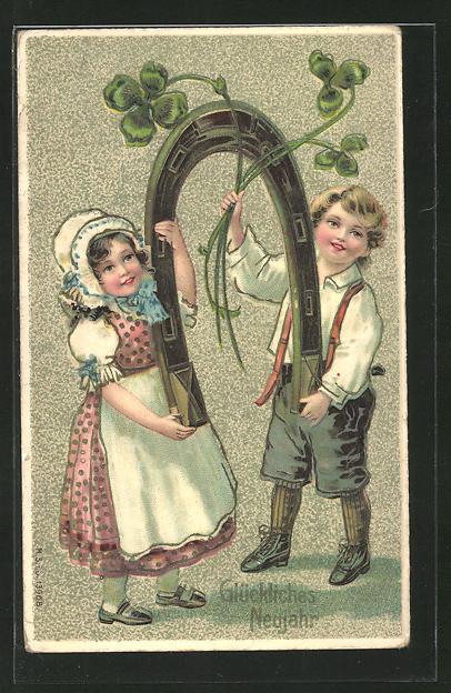 Präge-AK Neujahrsgruss, Kleines Paar mit Hufeisen und Klee
