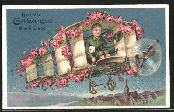 AK Namenstagsgratulant im rosengeschmückten Flugzeug