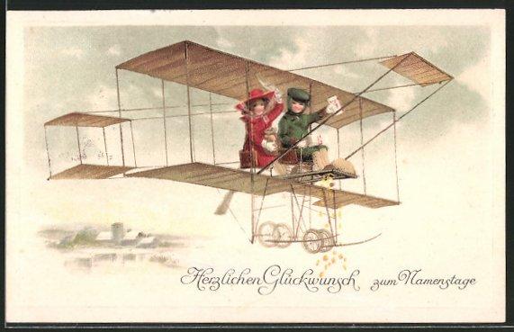 Präge-AK Namenstagsgratulanten im Doppeldecker-Flugzeug