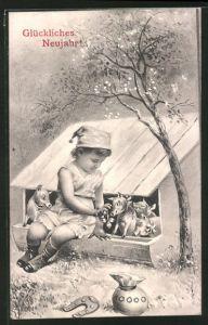 AK Glückliches Neujahr!, Kind mit Schweinen und Glücksbringern
