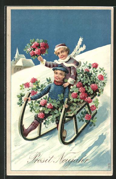 AK Kinder sitzen mit Blumen auf ihrem Schlitten