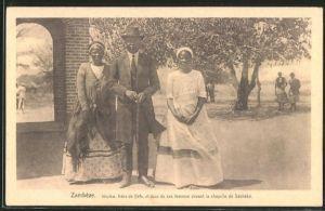 AK Séshéké, Imuiko, frère de Véta, et deux de ses femmes devant la chapelle