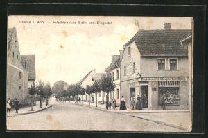 AK Güsten i. Anh., Friedrichplatz Ecke und Siegestal mit Buchbinderei & Papierhandlung