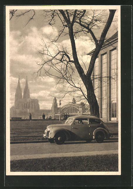 AK Köln a. Rh., Ford-Auto in Deutz mit Blick zum Dom