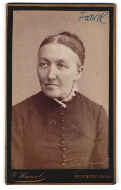 Fotografie R. Haensel, Reichenberg, Portrait Frau mit zusammengebundenem Haar