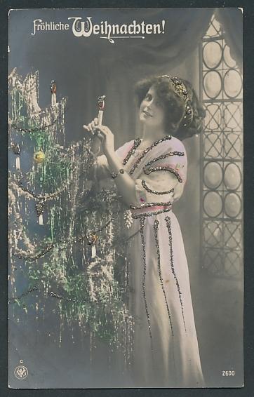 Glitzer-Perl-AK Dame schmückt den Weihnachtsbaum,