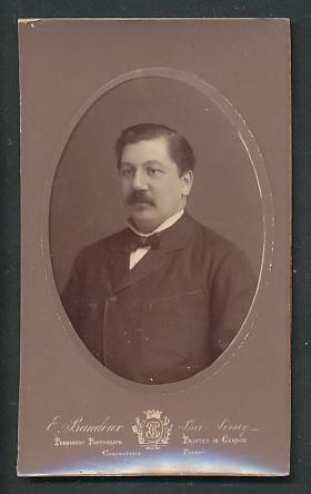 Fotografie E. Baudoux, Jersey, Portrait Herr mit Oberlippenbart