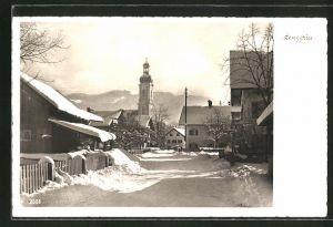 AK Lenggries, Strassenpartie im Winter mit Blick zur Kirche
