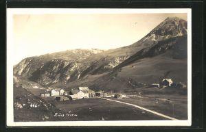 AK Zürs, Ortsansicht mit Berglandschaft