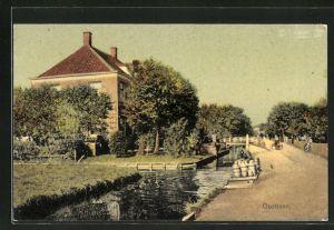 AK Oostzaan, Kanalpartie mit Haus und Brücke