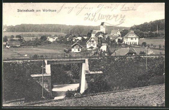AK Steinebach a. Wörthsee, Ortspartie mit Häusern und Eisenbahndurchgang