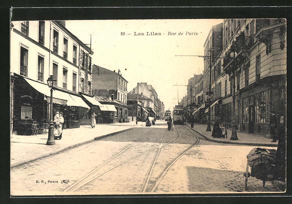 AK Les Lilas, Rue de Paris, Strassenbahnen
