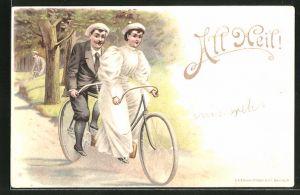 AK Liebespaar fährt auf einem Tandem-Fahrrad