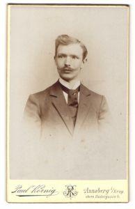 Fotografie Paul Körnig, Annaberg i/Erzg., Portrait junger Herr mit zeitgenöss. Frisur