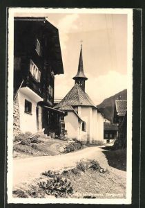AK Compadials bei Disentis, Partie am Hotel Pension Badus mit Blick zur Kirche
