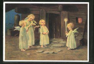 Künstler-AK Schönermark: singende Weihnachtsengel vor einer Haustür