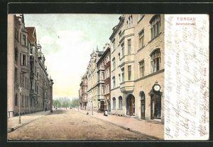 AK Torgau, Bahnhofstrasse mit Geschäft und Wohnhäusern