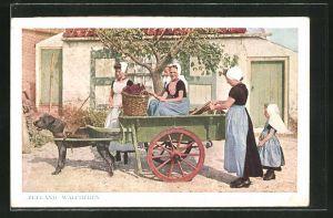AK Walchersche hondenkar, Frauen sitzen auf einem Hundegespann