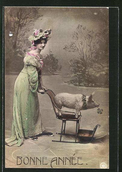 AK Dame mit Schwein auf einem Schlitten