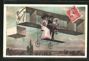 AK Bonne Année, Familie in einem frühen Flugzeug