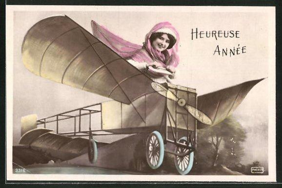 AK Heureuse Année, Frau in einem frühen Flugzeug