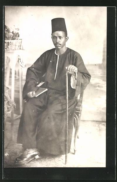 AK Afrikanischer Mann mit Fez und Spazierstock