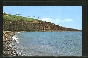 AK St. Kitts, Strandpartie mit grün bewachsenem Hügel